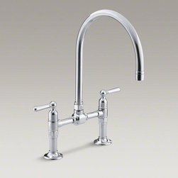 KOHLER Polished Stainless Hirise Two-hole Deck-mount Bridge Kitchen Sink Faucet - HiRise faucets combine the concepts of vintage plumbing with the strength and beauty of stainless steel to create truly sophisticated designs. This deck-mount bridge faucet reintroduces a classic design that suits urban lofts as well as traditional kitchens. The high clearance of this gooseneck swing spout allows you to easily fit larger dishes underneath for cleaning, and its fully rotating design makes it convenient for prep and cleanup tasks. This faucet is outfitted with easy-to-install and leak-free UltraGlide valves for excellent performance.