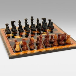 Black and Brown Alabaster Chess Set with Inlaid Wood Frame - You won't be able to resist the Black and Brown Alabaster Chess Set with Inlaid Wood Frame. Beautifully crafted in Italy by Chiellini this alabaster set includes a gorgeous board with a border of inlaid wood and matching chess men. These functional pieces are also works of art with a vibrant reddish brown and black color scheme. The board measures 15 inches on each side. King height is 3 inches with a base width of 1.175 inches. About WorldWise Imports:Specializing in retail and online merchants Worldwise Import founder Cheryl Stern has assembled a team that has the experience necessary to import the very best international products. Since 2001 the team has traveled the world to find and supply the finest in chess backgammon cribbage and other traditional games as well as some exotic and not so traditional games. Worldwise Imports' commitment to excellence has helped it become a leader in world import markets.