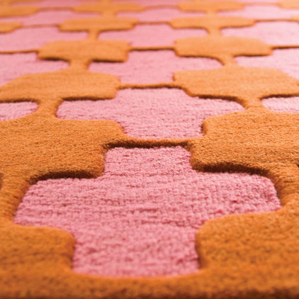 Guest picks pink and orange Angela adams rugs