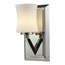One Light Chrome Matte Opal Glass Bathroom Sconce - This one light vanity uses an exquisitely designed, angled chrome arm to hold a uniquely shaped, warm glowing matte opal shade.