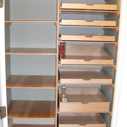 Closet and Walk-In Pantries - This pantry has scooped handles on the pull out shelves on the right and standard fixed shelves on the left.