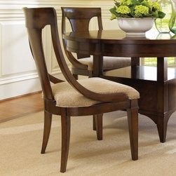 "Hooker Furniture Abbott Place Sling Back Dining Side Chair - Set of 2 - Perfect from every angle, the Abbott Place Sling Back Dining Side Chair - Set of 2 looks as good from the back as it does from the front. Featuring durable solid wood and veneer construction for lasting beauty, the warm cherry finish is inviting. The neutral and gorgeous fabric upholstery isn't just for the seat, the back gets to show off as well. Sit a few of these in your dining space, and watch them fill up fast.Not available for sale in, or delivery to, the state of California.About Hooker Furniture CorporationFor 83 years, Hooker Furniture Corporation has produced high-quality, innovative home furnishings that seamlessly combine function and elegance. Today, Hooker is one of the nation's premier manufacturers and importers of furniture and seeks to enrich the lives of customers with beautiful, trouble-free home furnishings. The Martinsville, Virginia, based company specializes in lifestyle driven furnishings like entertainment centers, home office furniture, accent tables, and chairs.Construction of Hooker FurnitureHooker Furniture chooses solid woods and select wood veneers over wood frames to construct their high-quality pieces. By using wood veneer, pieces can be given a decorative look that can't be achieved with the use of solid wood alone. The veneers add beautiful accents of color and design to the pieces, and are placed over engineered wood product for strength. All Hooker wood veneers are made from renewable resources and are located primarily on the flat surfaces of the furniture, such as the case tops and sides.Each Hooker furniture piece is finished using up to 30 different steps, including 13 steps of hand-sanding and accenting. Physical distressing is done by hand. Pieces receive two to three coats of solid lacquer to create extra depth and add durability to the finish. Each case frame is assembled using strong mortise-and-tenon joints, which are then reinforced by mechanical fasteners and glue. On most designs, end panels extend to the floor to add strength and stability. Panel-style furniture features strong panel and frame construction to help avoid warping.Your Hooker furniture features finished case interiors to eliminate unsightly ""raw wood"" and to help protect items you may store inside drawers or cabinets. Drawer parts are given a urethane or lacquer finish to create smooth action and durability. All drawers use dovetails, either English or French, for years of problem-free use. Drawer bottoms are constructed from plywood and attached to the plywood drawer sides via the use of hot glue and/or wood glue blocks. Most drawers are full width, depth, and height to provide the maximum amount of storage space."