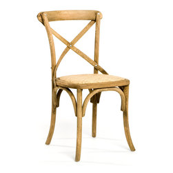 Parisienne Cafe Chair - Natural Oak - Solid oak with a rattan seat, the Parisienne Cafe Chair explores the possibilities for design which are inherent in relatively few pieces of beautifully-carved wood.  Its limed finish adds an exquisite cultured look which adds a perfect panache to interiors that rely on weathered, distressed textures, but can also be used boldly to bring depth to a collection of more polished woods.
