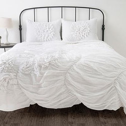 Home Decorators Collection - Hush Bedding Set - The gorgeously light and airy 100% cotton voile fabric of our Hush Bedding Set is gathered to create dramatic ruffles and pleats. Artfully-rendered flower embellishments add the perfect finishing touch. This comforter and sham set has timeless romantic appeal. Comforters feature 100% cotton voile front and 100% cotton back with polyester fill. Dry clean only. Twin set includes: Twin comforter, 1 standard sham. Queen set includes: Queen comforter, 2 standard shams. King set includes: King comforter, 2 king shams.