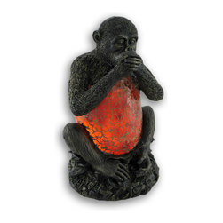 """Zeckos - """"Speak No Evil"""" Monkey Crackle Glass Accent Lamp - This incredibly cute 'speak No Evil monkey accent lamp makes a fun gift for friends and family, with the top and bottom of the monkey being made of cold cast resin, and his belly is made of epoxy set crackled glass to give off soft orange light. The lamp is 9 1/4 inches tall, 5 1/2 inches long and 5 inches deep, making it a perfect accent for end tables and nightstands. It takes one nightlight style bulb (included), and the bulb is easy to replace. It comes with a 6 foot light cord, containing the on/off switch. It's a perfect gift for any monkey lover."""