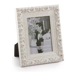 """Origin Crafts - Vintage white wood picture frame - Vintage White Wood Picture Frame Amongst the twenty arrondissements or districts that make up Paris there is a former fortress which stands proud as the focal point of district number one ? the Louvre. A majestic masterpiece where priceless art is encased in classic elegance, founded in the spirit of authentic French tradition. It was here in the Louvre, inspired by its magnificence and contribution to modern culture that Vintage was born. Dimensions (in): Width: 2, Height: 1 1/4 Holds (4""""x6"""", 5""""x7"""", 8""""x10"""") photos. By Roma Moulding - Roma Moulding uses only the highest quality materials. Roma owes it?s renown to exquisite details: meticulous applications of gold and silver leafing, genuine woods, exotic veneers, patinas, superior lacquers and finishes all done by hand. Roma employs time proven techniques to achieve the stunning finishes other manufacturers strive to achieve. Ships within Five Business Days."""