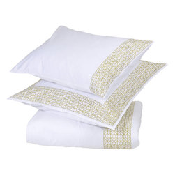 Villa Home - Villa Home Obi Duvet Cover - In a frame. The bright white color of Villa Home's Obi Duvet Cover is embellished by an elegant geometric pattern. Cotton sateen provides a subtle sheen, and the versatile palette can be paired with other neutrals or emboldened by brights. Add the Obi Sham to create a completely coordinated sleeping space. Available in multiple colors and sizesShams not included100% cotton sateen