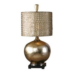 Uttermost - Uttermost 27944-1 Julian Table Lamp In Champagne Leaf - This glass lamp is finished from the inside with an antiqued silver/champagne leaf and cast aluminum accents. The round drum shade is constructed from small spirals, hand forged out of wire with an antiqued silver finish and a silken champagne inner liner