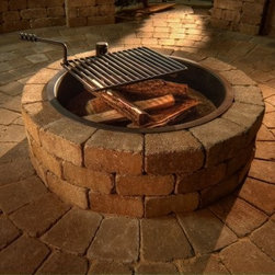 Necessories Compact Fire Ring with Grate - Please note: This item does not include to-the-door delivery. This item includes curbside delivery.Stack up the wood and kick back to enjoy the glow of your Necessories Compact Fire Ring with Grate. Made of reliable stone, this fire ring can stand up to the elements. It features a heavy-gauge steel insert that protects the handsome block. A swivel cooking grate makes outdoor dining a snap. This DIY fire ring assembles in an afternoon and is easy because it comes with all necessary materials. You get pre-cut concrete block sized to fit, steel reinforcements, Super-Stik adhesive, gloves, and easy-to-read instructions. With a range of different color options, you can select the one perfect for your backyard.Note: Review any building restrictions or construction permit requirements before installation of an outdoor fireplace. Contact your local zoning commission/homeowners association for details.About NecessoriesNecessories is a third generation family business based in Rochester, Minnesota. Necessories has a solid foundation in mortarless concrete manufacturing and construction that dates back to 1914. They are recognized as an innovator of attractive, high-quality landscape construction materials. Necessories is a collection of Outdoor Living Kits. This is a unique line of outdoor living kits that make hardscaping affordable and easy. Each kit comes packaged with all you need to build including pre-cut concrete block, Super-Stik adhesive, and easy to read course by course assembly instructions. These outdoor living kits require no cutting, no guessing, no hassles -- no problem.