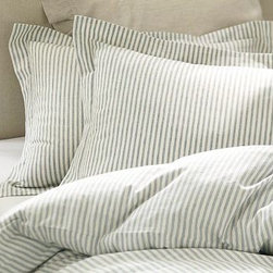 Vintage Ticking Stripe Duvet Cover, King/Cal. King, Blue - We replicated the appeal of vintage linen men's shirts in this duvet cover and sham, woven from a blend of linen and cotton for appealing softness and subtle luster. The yarn-dyed stripes have a cross-woven look that lends dimension to their design. Made of cotton/linen. Yarn dyed for vibrant, lasting color. Duvet cover and shams reverse to self. Duvet cover has hidden button closure; shams have envelope closure. Duvet cover, shams and inserts sold separately. Monogramming is available at an additional charge. Monogram will be centered on the cover and the sham. Machine wash. Catalog / Internet Only. Imported.
