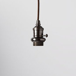 """Pendant Cord Kit, Bronze finish - Create customized task lighting for the kitchen, laundry room or utility room. Our cord kit comes in a choice of a bronze or polished nickel finish and has a smooth, rounded silhouette that brings a classic look to a variety of shades. 2.5"""" diameter, 3"""" high; 6' cord Socket is crafted of iron in a choice of antique bronze finish with a dark brown cloth covered cord or polished nickel finish with a gray cloth covered cord. Cord can be professionally shortened to the desired length up to 6'. On/off switch on socket. Recommended for use with our filament bulb (sold separately). UL-listed. Hardwire; professional installation recommended."""