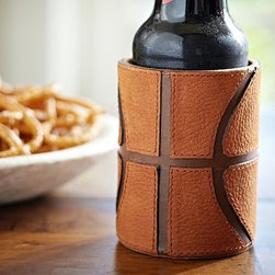 "Leather Basketball Bottle Cooler - Sheathed in our hand-stitched cooler, drinks keep their cool through every quarter. 3"" diameter, 4"" high Made of buffalo leather, and lined with polysuede. Hand-stitched details. Catalog / Internet Only."