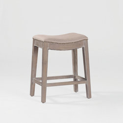 Vivian Counter Stool - This versatile backless stool features brass nailheads and herringbone linen fabric. The subtle curve of the seat and natural cloudy finish on the legs make this a great piece for your bar, counter, or table.