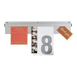 Design Ideas - Shortorder Rail - This thin rail displays notes, photos and all sizes and shapes of paper in an organized, clean fashion. No tape, no thumbtacks, no magnets, no adhesives. A simple flick of the wrist fits the paper securely in place. Lift the paper and the rail releases the document without any blemish to the page. Ideal for phone messages, notes, photos, recipes and shopping lists, or children's drawings. Mounting hardware included.