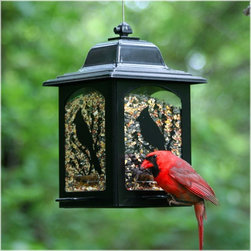Perky Pet - Perky Pet Birds and Berries Lantern Bird Feeder Multicolor - 363 - Shop for Feeders from Hayneedle.com! The Perky Pet Birds and Berries Lantern Bird Feeder has U-shaped perches that are for the birds. Literally. Research shows birds prefer the U-shape perch. This handsome wild bird feeder is sure to attract a flock of feathered friends to your garden. It has a classic lantern shape with screen printed design black powder-coated finish to resist the elements and a Sure-Lock cap system to keep the squirrels at bay. This wild bird feeder holds up to 5 pounds of birdseed and has four feeding stations so all your bird friends have a spot to perch.About WoodstreamWoodstream has been creating innovative garden pet and wild bird solutions for years. Since 1958 they've been crafting a unique line of wild bird feeders to make life more colorful for birders and easier for their feathered friends. Theyve done the research to design feeders that will entice more birds to your yard while adding style to your surroundings. Woodstream wild bird feeders come in a variety of sizes shapes finishes and perch options. Youre sure to find the perfect gift for you or the birder in your life.