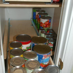Pull Out Pantry Shelves - The homeowners are still able to use the space on either side of the pull out shelf for storage.