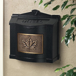 Traditional Wall-Mount Mailbox with Leaf Accent - Black with Antique Bronze - Classic design, a solid brass accent plate with leaf emblem, and traditional MAIL inscription on lid make this quality mailbox a wonderful addition to your home. Made from cast aluminum, this mailbox features a lid that can stay open in the upright position and closes softly on pads for quiet operation.