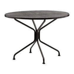 Woodard - 42 in. Round Umbrella Table w Standard Leg - 4 Spokes (42 in./4 Spokes) - Choose Size/Spoke: 42 in./4 Spokes. All products are made to order. Orders cannot be cancelled after 5 calendar days. If order is cancelled after 5 calendar days, a 50% restocking fee will be applied. Wrought Iron frame. Height: 29 in. H (48 lbs.)