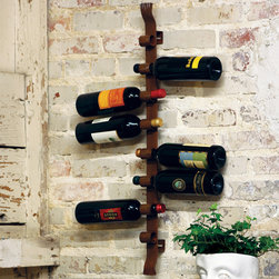 Rustic Iron Wall Wine Rack - The ultimate space saving Rustic Iron Wall Wine Rack accommodates a whopping eight bottles and looks beautiful, too. The rack's rustic patina and simple design means it will look spectacular in almost any room. Easy to install.