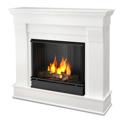 Real Flame - Chateau Ventless Gel Fireplace in White - Includes: Mantel, firebox, hand painted cast concrete log, and screen kit. Solid wood and veneered MDF construction. Uses Only Real Flame 13oz Gel Fuel Cans, not included. Assembly Required. Uses clean burning Real Flame Gel fuel emitting up to 9,000 BTUs of heat per hour lasting up to 3 hours. 40.9 in. W x 11.8 in. D x 37.6 in. H (67.6 lbs.)The Chateau Fireplace features the clean lines and classic stylingfamiliar to stone mantels, realized in wood. In three great finishes, this design is sure to compliment a variety of decor, from classic to contemporary. The hand-painted log set and bright crackling flame add to the realistic look of this Real Flame Gel Fuel Fireplace. Uses 3 - 13oz. cans of Real Flame Gel Fuel.