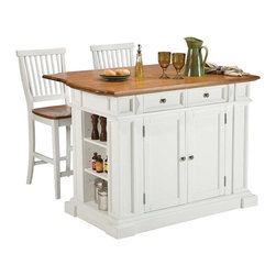 Home Styles - Home Styles Large Kitchen Island Set with 2 Stationary Stools - Antique White & - Shop for Kitchen Islands from Hayneedle.com! The Home Styles Large Kitchen Island Set with 2 Stationary Stools - Antique White & Oak offers a variety of culinary possibilities. Antique white has a homey country feel. Spacious and versatile this island is durably constructed of solid hardwoods and engineered wood with antique white base and distressed oak finished top. Perfect for food prep and serving the top is all wood. When you need a bigger work surface or want to sit and enjoy a meal simply raise the drop leaf for more counter space. With the drop leaf extended the island depth increases from 26.5 inches to 36 inches. For storage the island has adjustable shelving on both ends two utility drawers and two cabinet doors that open to adjustable shelves. The easy glide self-closing drawers contain removable dividers for added convenience. Raised detail on the cabinet doors and antiqued brushed-nickel hardware enhance the warm classic style. Included are two matching stools constructed of hardwood solids and veneers in a whtie & oak finish with slatted backs footrests and wood seats that provide added comfort and support. About Home StylesHome Styles is a manufacturer and distributor of RTA (ready to assemble) furniture perfectly suited to today's lifestyles. Blending attractive design with modern functionality their furniture collections span many styles from timeless traditional to cutting-edge contemporary. The great difference between Home Styles and many other RTA furniture manufacturers is that Home Styles pieces feature hardwood construction and quality hardware that stand up to years of use. When shopping for convenient durable items for the home look to Home Styles. You'll appreciate the value.