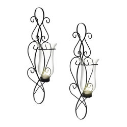 Danya B. - Baroque Sconce Set - Stately and shapely, these wrought iron sconces will sit regally on your wall. This set of two Baroque-style sconces feature elegant scrollwork and glass hurricanes for holding your favorite tea light or votive candle.