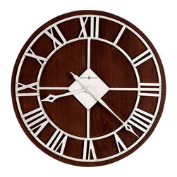 Howard Miller - Prichard Wall Clock in Espresso Finish - This 15 in. diameter clock features a satin Nickel finished metal wall clock on an Espresso finished back panel. The dial features stamped Roman numerals and satin Nickel finished hour and minute hands with open fret cut diamond tips. Quartz, battery operated movement. Requires 1 AA battery (not included). 15 in. Dia. x 1 3/4 in. H