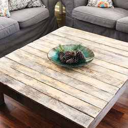 The Original Reclaimed Pallet Wood Coffee Table - The natural finish let's the wood speak for itself with all of the beautiful scruffs and scrapes from being weathered naturally. Each table is hand crafted using upcycled and reclaimed pallet wood. We bring out all of the details with a simple clear coat of water-based poly on the top. The frame of the table is done in a water-based american walnut stain.