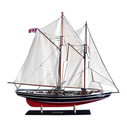 """Handcrafted Model Ships - Bluenose Limited 32"""" - Model Sailing Yacht - Not a model ship kit. Attach. Sails and Bluenose yacht models are Ready for Immediate Display This museum-quality scale replica of the Bluenose 2 is certain to be the conversation-piece and highlight of any room, ideal for proud display on any shelf or mantle. Exquisite details and precise craftsmanship in this Limited Edition model of the famous Canadian schooner Bluenose 2 are the hallmarks of these fine yacht models. 35 inch Long x 5 inch Wide x 25 inch High (1:60 scale)."""