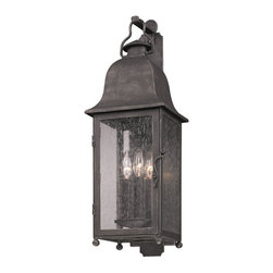 Troy Lighting - Larchmont Wall Lantern - Larchmont Wall Lantern is made from hand-forged iron in an aged pewter finish and either clear or frosted shade. Available in small, medium or large versions. Also available in an incandescent or compact fluorescent version. Either (2), (3) or (4) 60-watt, 120 volt B10 candelabra base incandescent bulbs are required, but not included or one GU24 compact fluorescent bulb comes included. Dimensions: Small: 6W x 18.75H x 7.875D. Medium: 8W x 25H x 9.75D. Large:  10W x 31.5H x 11.25D.