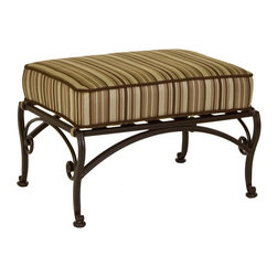 O.W. Lee - O.W. Lee Ashbury Aluminum Ottoman - 1588-O-SP11-GL02A - Shop for Ottomans and Footstools from Hayneedle.com! There is an elegance that naturally appears in the virtue of utility and the O.W. Lee Ashbury Ottoman establishes with a flourish both elegance and usefulness within your outdoor collection. This versatile piece can be moved around your outdoor living area functioning in different roles depending on the needs of you and your guests. As an extra surface space this ottoman can hold drink trays books games or any personal items you or your guests need to have close at hand. If a few more friends show up than you had planned on the ottoman's thick cushion allows you to provide comfortable extra seating without having to drag out mismatched chairs from storage. And when you find a little time to yourself you can relax out in the fresh air while you prop your feet up on this ottoman and let the rest of the world drift away. The sensually curving metalwork of the legs and their braces is hand forged and hammered bringing a uniquely masterful craftsmanship to this piece and adding to your outdoor decor a classic appeal that also possesses a fashion-forward individuality.Materials and construction: Only the highest quality materials are used in the production of O.W. Lee Company's furniture. Carbon steel galvanized steel and 6061 alloy aluminum is meticulously chosen for superior strength as well as rust and corrosion resistance. All materials are individually measured and precision cut to ensure a smooth and accurate fit. Steel and aluminum pieces are bent into perfect shapes then hand-forged with a hammer and anvil a process unchanged since blacksmiths in the middle ages. For the optimum strength of each piece a full-circumference weld is applied wherever metal components intersect. This type of weld works to eliminate the possibility of moisture making its way into tube interiors or in a crevasse. The full-circumference weld guards against rust and corro