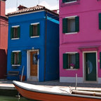 PrintedArt - Cute Burano Homes - Print is made with archival pigment inks for best color saturation and contrast with a 75-year guarantee against fading or discoloring. Face-mounted to optically clear acrylic to create a float-on-the-wall piece of art. Also available mounted on aluminum dibond boards.