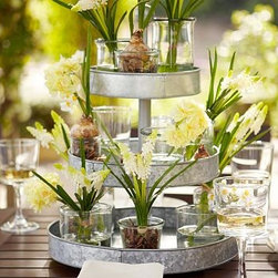 "Galvanized Metal 3-Tier Stand - This tiered stand is perfect for entertaining. You can put food in it for a serving piece or decorate it with vases of flowers. Either way it's a great centerpiece. Since it's galvanized steel, it can stay outside in the element and would look great with plants on it year round.Galvanized SteelDetails: Tiered Stand: 14.75"" diameter, 20.5"" high"