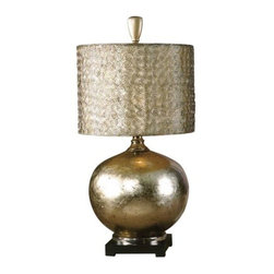 Uttermost - Julian Table Lamp by Uttermost - The Uttermost Julian Table Lamp is a gleaming metallic fixture, both inside and out. Designed by Carolyn Kinder, it features a drum-shaped shade hand-forged out of small spirals of wire, finished in antique silver and lined with champagne silk. This lustrous structure is matched by the base, which is a glass sphere finished on the inside with an antiqued silver and champagne leaf.Since 1975, Uttermost has made it their mission to make great home accessories at a reasonable price. From their headquarters in Rocky Mount, Virginia, Uttermost continues to meet this goal with sophistication and grace through their current line of quality, designer-driven lighting, home furnishings and accessories.The Uttermost Julian Table Lamp is available with the following:Details:Round drum-shaped shade made out of small hand-forged wire spirals, with antiqued Silver finish and silken Champagne inner linerGlass form finished from the inside with an antiqued Silver/Champagne Leaf and Cast Aluminum accents3-way switchDesigned by Carolyn KinderLighting:One 150 Watt 120 Volt Incandescent lamp (not included).Shipping:This item usually ships within five business days.