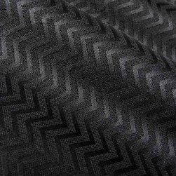 Hidalgo Upholstery Fabric in Black - With its check pattern, Hidalgo Upholstery Fabric in Black is a perfect way to add black into interior designs without going too bland. This fabric also has a soft texture, making it even more appealing. Made from a blend of 46% rayon, 37% polyester, and 17% cotton, this durable fabric passes 45,000 double rubs on the Wyzenbeek Abrasion Test. Cleaning Code: S; UFAC: Class I; passes CA117 Test. Width 54; repeat: 1″ V x 2″ H.