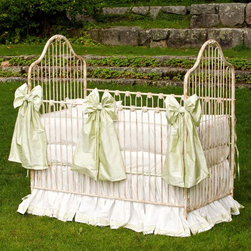 Corsican - Corsican Scalloped Iron Crib - 6862-101 - Shop for Cribs from Hayneedle.com! Choose the unbreakable Corsican Scalloped Iron Crib for your baby's nursery. Each Corsican crib is custom-made when you order it hand-forged in solid wrought iron by craftsmen dedicated to quality. This crib has narrow slats that are accented on the side rails. The headboard and footboard have a regal sloped shape that completes the majestic look. The side rails are stationary to keep your baby safe and secure and the mattress height can be adjusted as your baby grows. It's available in several hand-applied finishes so you can get a crib that matches your nursery's decor. Uses a standard size crib mattress (not included). Note: This item can only be shipped within the 48 contiguous states. Dimensions: Crib: 54L x 30W x 53H in. Headboard/Footboard: 53H in. Side rails: 36H in. JPMA certified (requirements developed and published by ASTM International). About CorsicanWith a commitment to quality and attention to detail Corsican has been manufacturing iron furniture and accessories for more than 40 years. Their skilled craftsmen uphold a tradition of handcrafted beauty personal care and attention to detail.