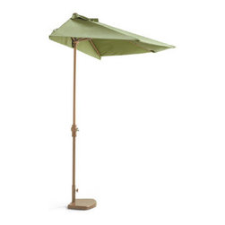 Grandin Road - Outdoor Half Umbrella with Pole - Provides shade without taking up a lot of room, so it's great for tight spaces. Powdercoated aluminum frame, pole, and base. All-weather construction. Outdura &#174 canopy resists fading, even in the blazing sun. Easy-to-operate crank. Our Outdoor Half Umbrella with Pole is the perfect shade over a door, on a balcony, or along walls or windows. Mounting is not necessary &#151 a sturdy base keeps the half-umbrella tightly against any flat surface. . . . Outdura canopy resists fading, even in the blazing sun. .