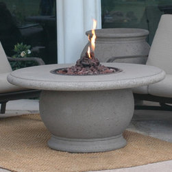 American Fyre Design - American Fyre Amphora Fire Pit Table - Cafe Blanco Multicolor - 610-CB-11-V2PC - Shop for Fire Pits and Fireplaces from Hayneedle.com! The American Fyre Amphora Fire Pit Table Cafe Blanco is sure to add an inviting glow and modern style to your outdoor living space. The large table top provides plenty of room for beverages ensuring an enjoyable experience. With 32 000 BTU it ll provide enough heat to cozy up to on cool nights. The pedestal provides storage for a propane tank and a stainless-steel burner is included.About American Fyre DesignsR. H. Peterson Company a premium gas product manufacturer launched American Fyre Designs in 2013. This complete line of uniquely designed and handcrafted exterior fire features are meant to meet the growing demand for outdoor living products. Pre-fabricated exterior fireplaces fire tables urns pits walls and BBQ islands make up this unique line and each item is constructed of durable lightweight glass fiber reinforced concrete. Everything in the American Fyre Designs line is made in the USA and follows strict quality standards using advanced technology.