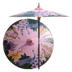 "Oriental-Décor - Peacock Garden (Pristine Pink) - This stunning and artistic patio umbrella depicts two peacocks in an Asian garden. Peacocks are symbolic of wholeness, dignity and pride in Oriental lore. Bring any outdoor setting to life with this fabulous pink patio umbrella.    - 7 foot umbrella pole constructed of rich stained oak hardwood.  - Each umbrella is entirely handcrafted down to the finest detail.  - Oil-treated cotton umbrella shades are all hand-painted by our master artists.  - Dual position shade height allows for full coverage or a better view of the painted shade.  - Waterproof and weatherproof.  - Two-piece pole fastens securely with a polished metal coupling.  - Pole diameter of 1.5"" easily fits into any standard size umbrella base or table.  - Optional umbrella base available - handcrafted from stained oak hardwood."