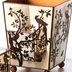 Mirror Wastebasket, Bird Silhouette - Practicality rejuvenated with beauty makes this reflective wastebasket a must-have for the study, bath, or boudoir. A bird pattern, inspired by ancient Asian garden motifs, graces the sides of the basket in rich chocolate. The mirror panels blend seamlessly with transitional decor while adding a touch of understated glamour. Furniture-style ball feet present a slightly-elevated look. Burnished piping on the edges and a golden-hued interior transform a utilitarian piece into an object of elegance.