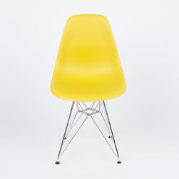 Eiffel Slope Chair in Mustard - Our Eiffel Slope Chair is inspired by an iconic design of the 1950s and 1960s. The original was born out of technological advancements that allowed a chair to be constructed out of a single mold of fiberglass. With the original mold no longer in production, today's designers have improved this process even further, resulting in a comfortable, stylish, lightweight chair. Replacing fiberglass with more eco-friendly polypropylene, the current iteration is as innovative as it is timeless. The base is made of chromed steel and resembles the structure of the famed Eiffel Tower. Our Eiffel Slope Chair takes this incredible design and makes it accessible and modern, featuring a smooth polypropylene seat that contours to your body. This chair is also one of our most versatile pieces, fitting in at the dinner table, conference table, or anywhere else you're looking to add some seating.