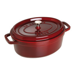 Staub - Staub Oval Cocotte - 7 qt. - Grenadine - 1103387 - Shop for Dutch Ovens from Hayneedle.com! Great meals start with the Staub Oval Cocotte - 7 qt. - Grenadine. This pan is cast iron and naturally retains and redistributes heat. The extra-heavy lid seals in moisture and features dozens of well-placed spikes continuously baste the food below ensuring your dish retains the full flavor of each ingredient. When it's time for clean up simply pop this pan into the dishwasher. The high-quality enamel coating resists scratches and will never discolor.About Staub CookwareFrom professional chefs to home cooks people with a passion for cooking rely on Staub cookware. Combining the utility of cast iron with the latest technology available Francis Staub designed his first enameled pot in 1974 in the Alsace region of France. Known for performance style and durability Staub has become the benchmark for enameled cast-iron cookware. Ideal for braising searing roasting and caramelizing food Staub's signature pots - called cocottes - feature an enameled interior with a matte black finish. Resistant to rust chipping and cracking cocottes are available in round and oval shapes in a variety of sizes and colors. Just right for slow-cooking food Staub cocottes are designed to provide even heat distribution excellent heat retention and continuous self-basting. The inside of each heavy snug-fitting lid features a series of bumps (or self-basting spikes) to allow continuous natural basting by distributing moisture throughout for extra flavor and tenderness. In addition to its signature cookware which is perfect for serving at the table Staub also offers pans for frying sauteing grilling and roasting as well as a variety of teapots accessories and gourmet specialty items.