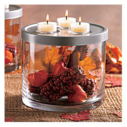"""Online Outlet - Versatile piece has endless uses! Fill the clear glass vessel with decorations of your choice and top with the textured metal lid that holds three tealights or a 3-wick pillar. For another look, use the lid as a base for the glass holder and set a pillar candle inside with the included leveling beads. Candles sold separately. 6"""" h, 7"""" dia."""