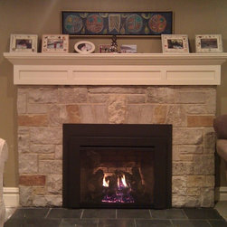 "Fireplace Xtrordinair - Gas Fireplace Inserts - Direct-vent gas fireplace insert with a ""clean face"" look installed into an existing masonry fireplace. We ran electric into this existing fireplace to operate the fan and back lights on the unit."