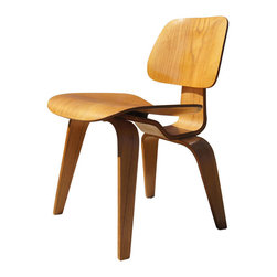 "Vintage Oak DCW Dining Chair by Eames for Herman Miller - An early model of a classic design, this DCW by Eames for Herman Miller is constructed out of oak plywood. It features the early oval shock mount on the back rest, and it is impressed with ""DCW"" on the underside."