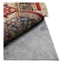 Premium Felted Rug Pad, 6' X 9' Oval - Preserve your rugs for years, keeping them securely in place and elegantly plush, by backing them with a hidden rug pad against your floor. This practical addition to luxury rugs and carpets is a must for homeowners who intend their carefully curated interior designs to last. The Premium Felted Rug Pad is made entirely of recycled fibers, including latex and additional choice synthetics, for the best possible durability and performance.
