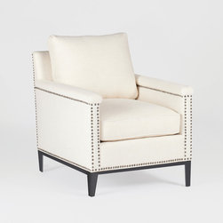 Weston Chair by Gabby - This occasional chair features clean, sleek lines and loose back and seat cushions for ultimate comfort without sacrificing it's transitional style. Nail head trim adds definition to the capped arm and the handsome metal base helps finish the look. Personalize the look with one of our exclusive fabrics and leathers.