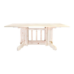 Montana Woodworks - Double Pedestal Dining Table - Hand crafted. Sawn square timbers and trim pieces for rustic timber frame design. Heirloom quality. Edge glued panels. Made from U.S. solid grown wood. Lacquered finish. Made in U.S.A.. Assembly required. 72 in. L x 40 in. W x 30 in. H (172 lbs.). Warranty. Use and Care InstructionsFrom Montana Woodworks, the largest manufacturer of handcrafted quality log furnishings in America comes the all new Homestead Collection line of furniture products.