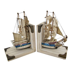 Pair Of Wooden Nautical Ship Bookends Whitewashed - This awesome pair of wooden bookends form an 1800`s tall ship. The bookends feature linen sails, string rigging and wooden masts,and a sun-bleached whitewash finish, with brass corner caps. Each bookend measures 9 inches tall, 5 7/8 inches wide and 3 3/4 inches deep. They are great conversation pieces, and they do a good job holding books up too. They make a great gift for book lovers, and look great in dens or libraries.