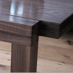 Cabinet makers Loughton, Essex, UK - Solid american black walnut coffee table commissioned by clients. Feature bridal joints at leg junctions. Solid laminated top for rigidity, which floats between the legs.